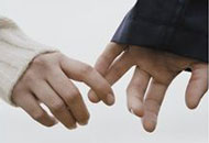 Couple's hands reaching out for each other
